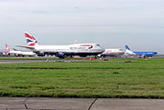 Queue of aircraft for take-off including jets from Virgin Atlantic, British Airways, Air India, and bmi