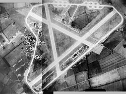 A 1946 aerial photograph of RAF Sculthorpe, the main runway runs diagonally with the technical and bomb dump on the left.