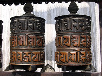"Nepalese scripts - Prayer wheels with the mantra ""Om mani padme hum"" in Ranjana script at Swayambhu, Kathmandu."