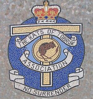 The Rats of Tobruk - Mosaic at the foot of the Rats of Tobruk Memorial, Queen's Park, Mackay, Queensland, Australia. Indicated is the Rats of Tobruk Association insignia.