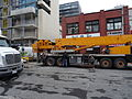 Removing the big boom crane from atop the almost finished reconstruction of the old National Hotel, 2015 03 07 (25) (16757905202).jpg