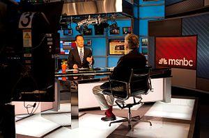 Richard Lui - Richard Lui interviews a guest for MSNBC.