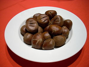 Roasted, unpeeled chestnuts; nuts grown in Cal...