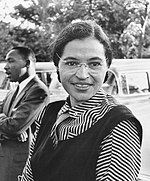 Rosa Parks in 1955, with Martin Luther King, Jr. in the background.