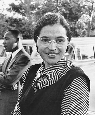 Rosa Parks - Rosa Parks in 1955, with Martin Luther King Jr. in the background