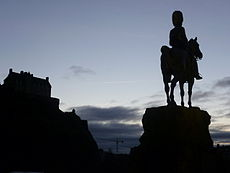The Royal Scots Greys Monument in the shadow of Edinburgh Castle.