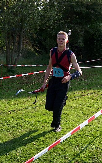 Run archery - Run archer with recurve bow and back quiver during a competition