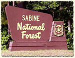 A sign for Sabine National Forest.