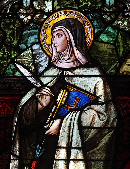 St. Teresa of Avila. In traditional Christian iconography, saints are often depicted with halos as a symbol of holiness. Saint Joseph's Catholic Church (Central City, Kentucky) - stained glass, St. Theresa of Avila detail.jpg