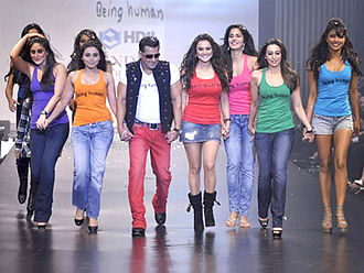 Salman Khan walking hand-in-hand with a group of colourfully-dressed actresses