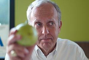 Scott Fisher (technologist) - Scott Fisher holding plastic apple