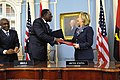 Secretary Clinton and Angolan Foreign Minister Asuncao Afonso dos Anjos Shake Hands After Signing a Memorandum of Understanding.jpg