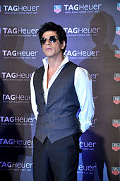 e7e53aa269 Shah Rukh Khan wearing sunglasses and a vest at a promotional event