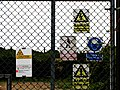Signs on gate to mobile telephone mast buildings - geograph.org.uk - 540317.jpg