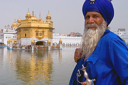 An Akali-Nihung Sikh Warrior at Harmandir Sahib, also called the Golden Temple Sikh.man.at.the.Golden.Temple.jpg