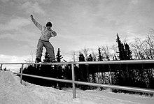 Snowboarding on railing.jpg