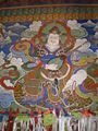 Songzalin Monastery main prayer hall entranceway artwork.JPG