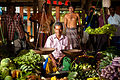 Sri Lankan middle aged street merchant (waist up outdoor portrait). Sri Lanka.jpg