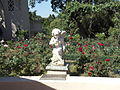 Statue and rose garden in garden of Virginia Robinson Estate.JPG