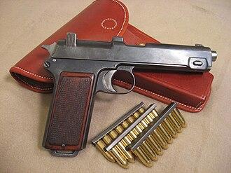 9×23mm Steyr - Steyr Hahn M1912 show with 9×23mm Steyr ammunition on stripper clips.