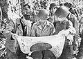 Stiwell with captured Japanese flag..jpg