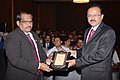 Subhash Ramrao Bhamre receiving a memento from the Secretary R&D and Chairman DRDO, Dr. S. Christopher, at the 58th Conference of International Military Testing Association (IMTA).jpg