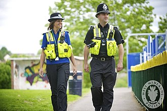 Police community support officer - A West Midlands Police PCSO (left) on foot patrol with a constable (right)