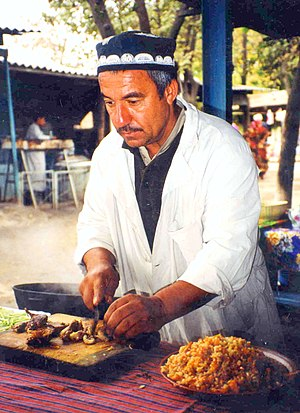 Tajik cuisine - A Tajik man makes plov.