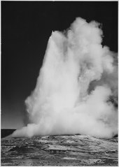 "Taken at dusk or dawn from various angles during eruption. ""Old Faithful Geyser, Yellowstone National Park,"" Wyoming. (v - NARA - 520017.tif"