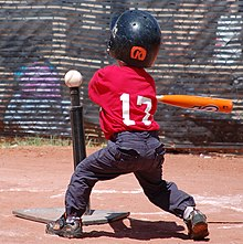 Tee ball player swinging at ball on tee 2010.JPG