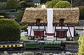 Thatched pub and train, Bekonscot.JPG