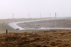 English: The A968 at Watlee on a very wet day ...