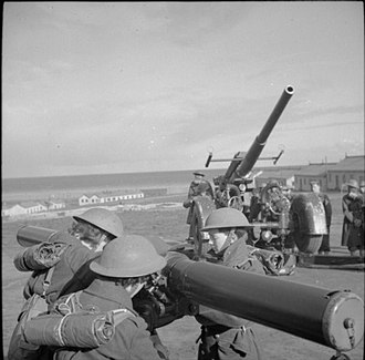 Weybourne, Norfolk - ATS women operate a rangefinder at the anti-aircraft training camp at Weybourne, 23 October 1941. A mobile 3.7-inch AA gun can be seen in the background.