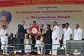 The Chairman, Port Trust of Chennai, Shri K. Suresh and the Chairman, NHAI, Shri Brijeshwar Singh presenting a memento to the Prime Minister, Dr. Manmohan Singh.jpg
