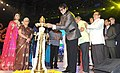 The Chief Guest Superstar Amitabh Bachchan lighting the lamp at the inauguration of the 45th International Film Festival of India (IFFI-2014), in Panaji, Goa. The Governor of Goa, Smt. Mridula Sinha.jpg