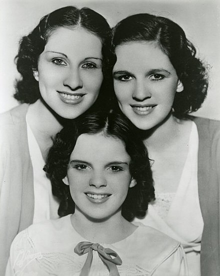 The Gumm Sisters, also known as the Garland Sisters, c. 1935: Top row: Mary Jane and Dorothy Virginia Gumm; bottom: Frances Ethel (Judy Garland) Gumm The Gumm Sisters.jpg