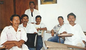 """George Simon (artist) - Simon with members of the Lokono Artists Group. Left to Right: """"Puffy"""" Clenkien, Telford Taylor, Ossie Hussein (standing), Foster Simon, George Simon and Lynus Clenkien"""