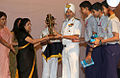 The Naval Children School quiz team receive the newly instituted NWWA Quiz Competition Rolling Trophy from Vice Admiral SPS Cheema.jpg