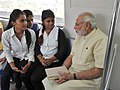 The Prime Minister, Shri Narendra Modi interacting with the co-passengers while travelling by the Delhi Metro to Faridabad on September 06, 2015 (1).jpg