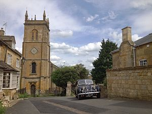 Father Brown (2013 TV series) - Image: The Square, Blockley, with St Peter and St Paul Church, and the Riley RMA used for filming Father Brown