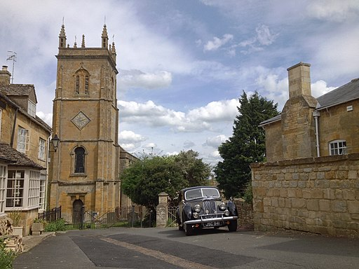 The Square, Blockley, with St Peter and St Paul Church, and the Riley RMA used for filming Father Brown