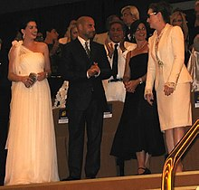 At the Venice premiere of The Devil Wears Prada: Front row: (left to right) Anne Hathaway, Stanley Tucci, Lisa Tucci and Meryl Streep. Valentino can be seen behind and between Stanley and Lisa Tucci, and Beatrice Borromeo is partly visible to Stanley Tucci's left.