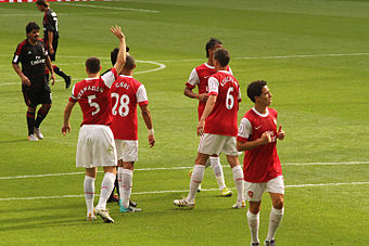 Vermaelen (left) with Arsenal in 2010. Thomas Vermaelen, Kieran Gibbs, Laurent Koscielny & Samir Nasri (4867513848).jpg