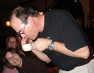 Tim Tam - A man performing a Tim Tam Slam