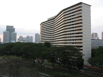 Toa Payoh - An apartment block in Toa Payoh New Town at Toa Payoh Lorong 6. The HDB Hub and point blocks at Toa Payoh Town Centre can be seen in the background.