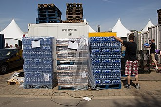 Festival workers supplying bottled water to the festival TomorrowLand 2014 (14689460411).jpg