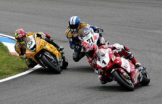 Superbike World Championship - James Toseland (1) on a Ducati leads Chris Walker (9) on a Kawasaki and Yukio Kagayama (71) on a Suzuki during a 2005 Superbike World Championship race