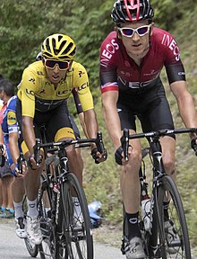 Geraint Thomas leading his teammate and yellow jersey wearer Egan Bernal and several other riders
