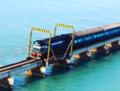 Train passing Pamban Bridge.png
