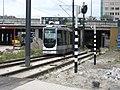 Tram onder het spoorviaduct in Schiedam.jpg